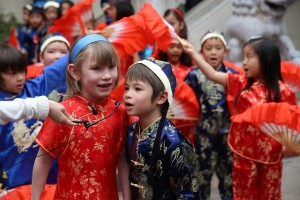 The american kids are playing for the shows that celebrating Chinese New Year